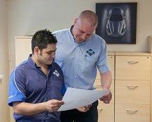 PAB team looking at CAD drawing