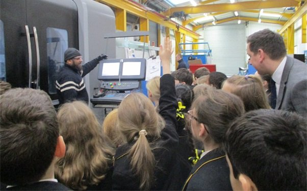 pupils from lichfield school inside factory